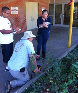 students and Weindorf measure raised beds