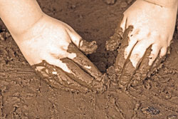 Hands in mud