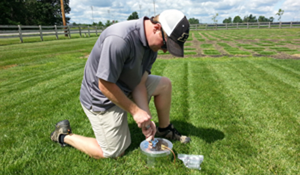 Collecting greenhouse gas samples from turf plots