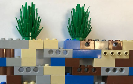 Lego blocks demonstrate organic matter, minerals, air, water in soil