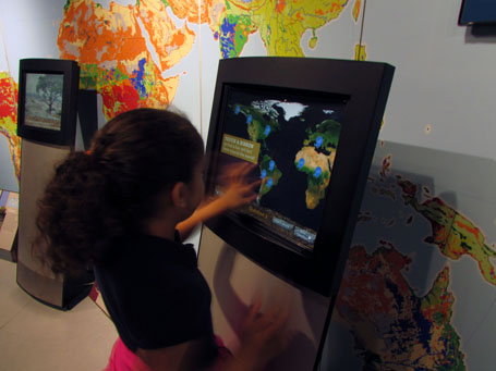 Girl viewing monitor with soils facts