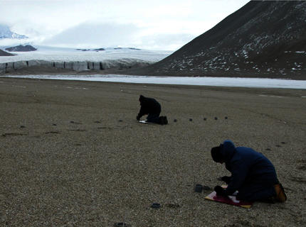 Two scientists working in Antarctic dry valley